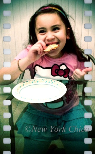 Little One trying Hungry Girl Flatbread pizza